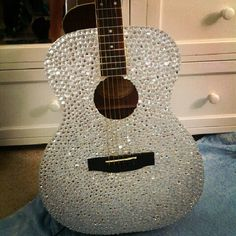 I am going to learn guitar this summer. Maybe I could obtain one similar to this... only in pink.