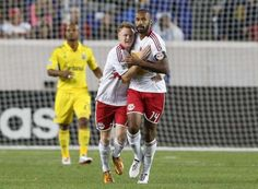 HARRISON, NJ - SEPTEMBER 15:  Thierry Henry #14 of the New York Red Bulls celebrates his goal in the first half against the Columbus Crew with teammate Dax McCarty #11 at Red Bull Arena on September 15, 2012 in Harrison, New Jersey.  (Photo by Jim McIsaac/Getty Images)