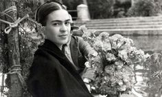 Frida Kahlo on a boat ride in the canal gardens of Xochimilco. Image via the  Vicente Wolf Photography Collection.