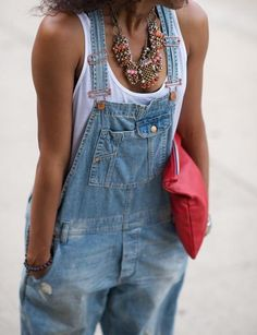 Dungarees, statement necklace, red clutch bag