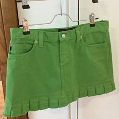 Juicy couture green jean skirt Cute Juicy couture mini skirt. Front and back pockets. Ruffle look at bottom.100% cotton. 13in long. 32in waist. Juicy Couture Skirts Mini