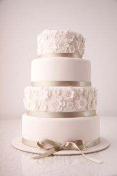 This cake definitley has the details :) The ribbon and flower effect give this cake a very elegant look.