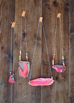 Kids use their hands to squeeze together bits of polymer clay and then use a flattening machine to make these unusual and colorful necklaces.