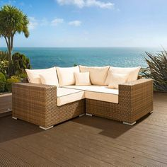Luxury outdoor garden L shape corner sofa/settee group brown rattan 16. Truly stunning in design, this 4 seater corner sofa gives a super high-class feel. This set consists 1 x Corner sofa piece, 2 x end pieces + clips to hold them together, 3 x scatter cushions and heavy-duty covers in green. Made from fully weatherproof PE rattan, hand woven over a rust resistant frame. Call 02476 642139 or email sales@quatropi.com or visit www.quatropi.com for additional information.