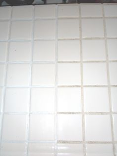 Before and after with a grout coating pen.