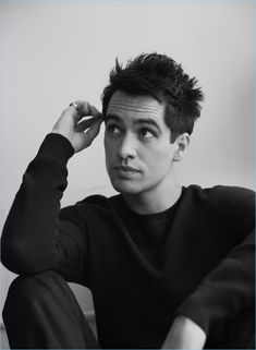 Singer Brendon Urie wears an Acne Studios sweater with Frame jeans.