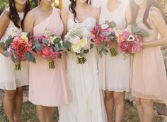 Pretty, coordinated bouquets with bridesmaids.