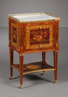 SMALL FRENCH LOUIS XVI TABLE, JACQUES BIRCKLE, ca. 1780. Material: oak and pine frame veneered with tulipwood, kingwood, sycamore, bois teinté and boxwood. Gilt bronze fittings. White Carrara marble top. H. 77.5 cm / 31 in, W. 39.5 cm / 16 in, L. 50 cm / 20 in