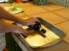 The easiest and cheapest way to cut glass bottles I've seen: Use a cake pan and tape the glass cutter to the bottom! This lady is a genius! AWESOME!!!