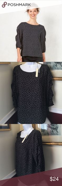 "LC Lauren Conrad Print Ruffle Sleeve Blouse A pretty Blouse by Lauren featuring ruffle sleeve detail for elegant style. Boatneck, 3/4 Sleeve with elastic. Back button keyhole closure, (extra button included) . Polyester. Color : Black w/White floral print. . Size: M ( flat across armpit to armpit 19.5"" and approx 24"" length). Brand new with tags. LC Lauren Conrad Tops Blouses"