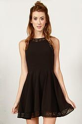 Nellie Lace Dress: Black circle lace fit and flare dress. Features a solid black panel in the front. Invisible zipper closure on back.