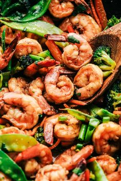 Garlic Shrimp Stir Fry is one of the easiest meals that is packed with so many delicious veggies and shrimp. Glazed in the most amazing garlic sauce, this will become an instant favorite! Wok Recipes, Stir Fry Recipes, Shrimp Recipes, Asian Recipes, Cooking Recipes, Healthy Recipes, Savoury Recipes, Healthy Meals, Clean Eating Shrimp