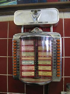 """Tableside Jukebox...Flip the """"pages"""", Drop in a coin and Push the button for your selection  ..It was a simpler time."""
