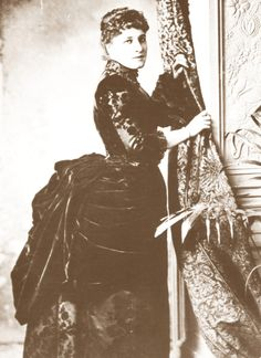 Lily dressed in the height of fashion circa 1885.