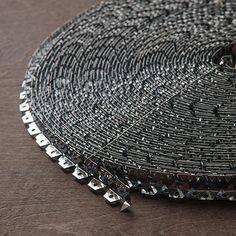 The Flexible Metal Tack Strip is a continuous metal strip that is used to fasten fabric on curved or straight areas. Generally, it is used to hold fabric in place where a straight cardboard tack strip will not work.