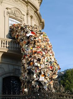 """As part of the Paper Biennial 2012 at the Meermanno Museum in The Netherlands, Spanish artist Alicia Martín created one of her significant book sculptures using thousands of books. Considered as one of the most significant contemporary spanish artists, Martín's work always deals with books as a constant raw material and source of inspiration."" Incredible."