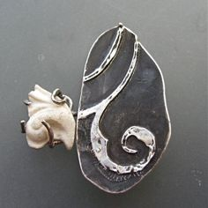 Lora Hart. Fragment Brooch #1...   Fine silver metal clay, sterling, steel, porcelain. Kiln fired, soldered.