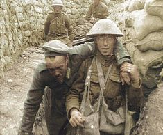 A British soldier brings back a wounded German prisoner at the Somme