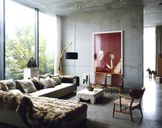 concrete living room with modern photo wall decor