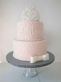 This cake was for a little girl with a princess themed birthday. The tiara and bow are gumpaste.