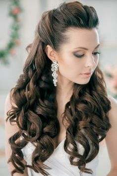 Brunette with long curls and with long earrings