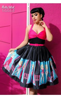 The Lydia is a dream of a dress! Made of high-quality cotton sateen, the Lydia has an ultra-flattering gathered twist bust in hot pink, curved adjustable straps that criss-cross at the back, and a tightly gathered full skirt in our custom Burlesque Performer print by Micheline Pitt. - See more at: http://www.pinupgirlclothing.com/lydia-dress-burlesque.html#sthash.KgcfJ6Lz.dpuf