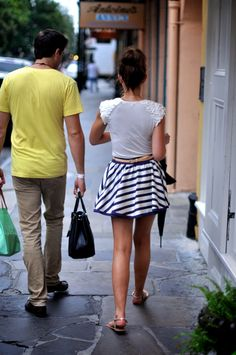 had to pin this... ok so cute skirt... but do you see her beau holding the purse. tehe
