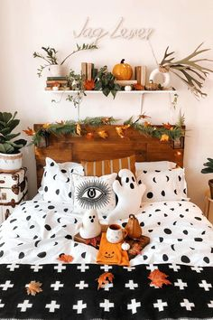 Because why can't every room be spooky? Add some pumpkins, black and white prints, and a ghost pillow to bring Halloween decorations into every room in your house. Photo via Halloween Room Decor, Creepy Halloween Decorations, Fall Halloween, Halloween House, Halloween Decorations Apartment, Halloween Living Room, Halloween Costumes, Halloween Inspo, Spooky Decor