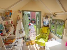 Shed envy and dogs on chairs.  Sewing shed.