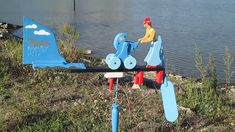 """Whirligig from www.WindWhirligigs.com. Wind-driven wooden whirligig """"Young woman with a baby stroller"""". Young mom shakes her baby in a stroller. Wood For Sale, Red Umbrella, Wind Spinners, Handmade Wooden, Young Women, Diy For Kids, Making Out, Baby Strollers, Angels"""