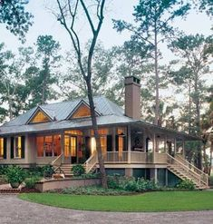 Tidal Haven, a Southern Living Home Awards Design has the front porches we Southerner's love! Not a log cabin, but I love the design.