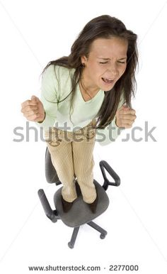 stock photo : screaming woman standing on the office chair - white background, headshot