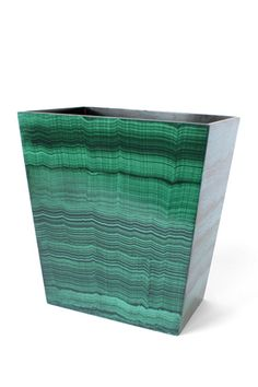 """""""Swap out an unassuming trashcan and upgrade with this emerald green malachite wastebasket from Dransfield & Ross, who offer an assortment of stingray, onyx, and lacquered bath accessories to suit any style."""""""