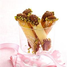Chocolate Anise Cannoli Recipe -Here's that something-special treat you've been looking to add to your holiday cookie trays! We guarantee these wonton-wrapped bites with anise, cherries, chocolate, brandy and pistachios will be gone in a twinkling. —Marie Rizzio, Interlochen, Michigan