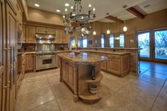 Custom kitchen in North Scottsdale, Alder cabinets, granite counters, Dacor range, Asko Dishwasher, Subzero Fridge, GE Monogram Wine Cooler.  Owner chose the best appliances for his use as he's the builder!