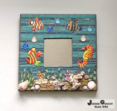 """Mosaic mirror, Under the sea (10""""x10"""" or 26x26 cm). Made with Venetian tiles, smalti, seashells, hand-made polymer clay figures, glass beads, mirror on a wood base."""