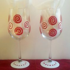 Red and white Swirls hand painted wine glass by GlassesbyJoAnne, $20.00