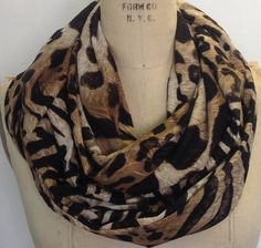 I am loving this scarf.  Animal print infinity scarf eternity scarf circle by DeZeStar