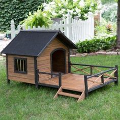 Dog house with a spacious, front deck is the perfect place to lounge in the sun and take a nap.