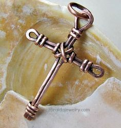 "Rustic wire cross is 1 7/8"" long"