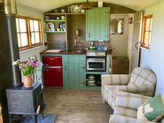 The kitchen area includes a gas stove, fridge, sink and simple cooking equipment - Vanlife & Caravan Renovation Tiny House Cabin, Tiny House Living, Tiny House On Wheels, Tiny House Design, Small Living, Muebles Shabby Chic, Casas Containers, Shepherds Hut, Cabin Kitchens