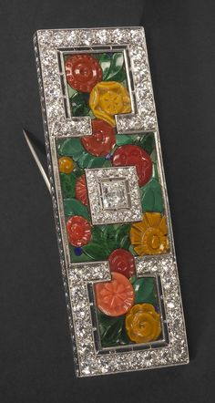 An Art Deco gold, platinum, diamond and gem-set brooch, Paris, circa 1925. Brooch with flower motifs in coral, malachite, lapis lazuli and set with old brilliant-cut diamonds. #ArtDeco