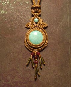 Macrame jewelry necklace with turquoise centerpiece by Mabutirat,  204 USD- very beautiful and unforgettable piece.