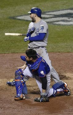 Kansas City Royals first baseman Eric Hosmer celebrated over New York Mets catcher Travis d'Arnaud after scoring in the ninth inning during game five of the World Series on Sunday, November 1, 2015 at Citi Field in New York.