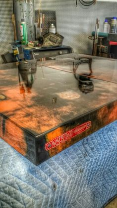 Table tops made from Chevrolet truck hood for a restaurant.   www.weldhouse.com