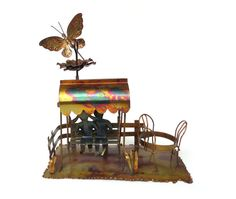 Copper Music Box Animated Sculpture, Big Platform Music Box Plays Love Story, Depicts Couple on Swing at Park or Café, Great Working Shape -- by ThirdFloorRetro on Etsy