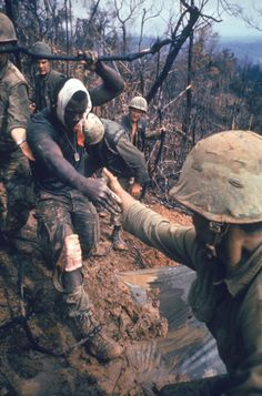 Larry Burrows. American Marines aid a wounded comrade during Operation Prairie near the DMZ during the Vietnam War, October 1966.