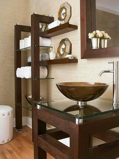 A clever mix of furnishings picked up at a home improvement center takes this small bathroom from simple to savvy on a modest budget. The visual trick: Stain all the wood pieces a rich, dark finish because dark stains are easiest to match. Bathroom Makeovers On A Budget, Budget Bathroom, Small Bathroom, Master Bathroom, Modern Bathroom, Bathroom Ideas, Basement Bathroom, Bathroom Shelves, Bathroom Organization