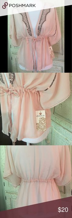 Sheer pink top with Gold Sequins This cute pink sheer shirt would be a great combo with a pair of jean capris and flat shoes,  put a little tank top underneath and you've got a complete outfit! 🎁🌺🎁 Andrew & Co Tops Blouses