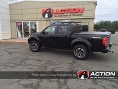 "2015 Nissan Frontier with installed 2.5"" SST Lift kit by ReadyLift Suspension Inc. and Trifecta tonneau cover by Extang"